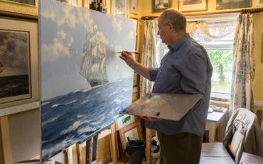 James Brereton at work in his painting studio